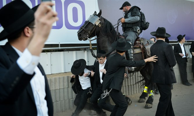 Haredi demonstrators clash with mounted officer in Bnei Brak