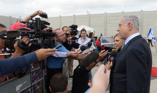 Prime Minister Netanyahu talks to reporters before flying to New York