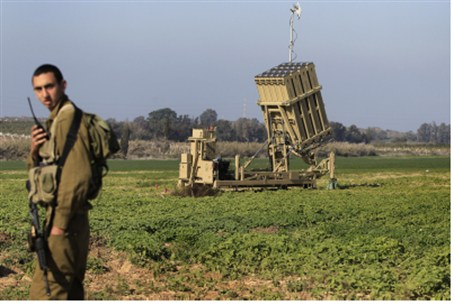 IDF soldier stands near part of Iron Dome sys