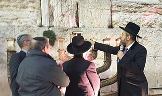 Watch: Chief Rabbi at Kotel Hanukkah lighting