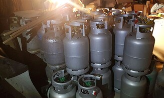 Police find 42 gas canisters in Bnei Brak storehouse