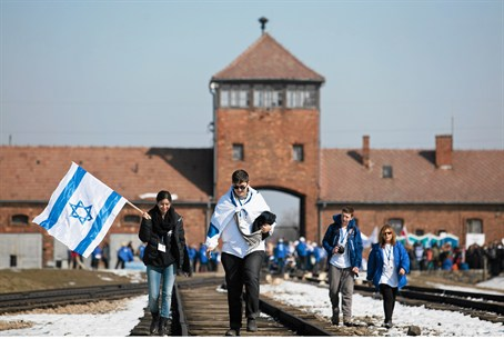 Jews carry Israeli flags as they walk through