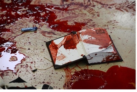 Bloodied prayer book in Har Nof attack (file)