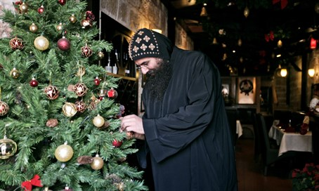 Monk with Christmas tree in Israel (illustration)