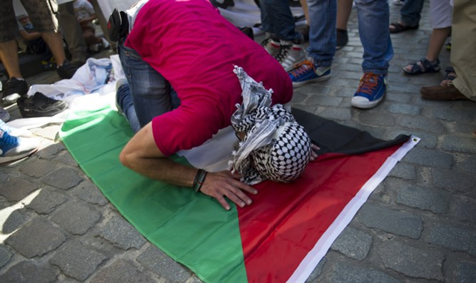 Pro-Palestinian protestor praying to Allah. France, July 2014.