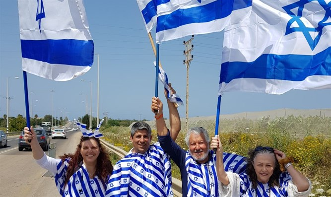 Avi Farhan and family wave Israeli flags