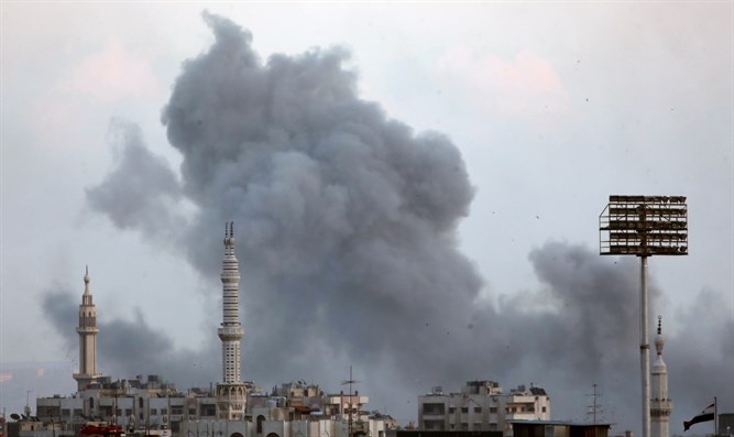 Smoke rises from Yarmouk