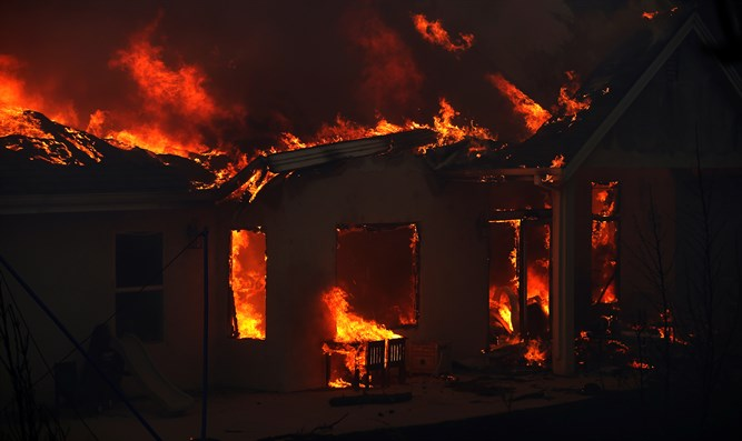 Home engulfed in flames (illustrative)