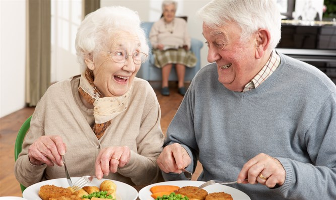 Senior citizens enjoy a meal together