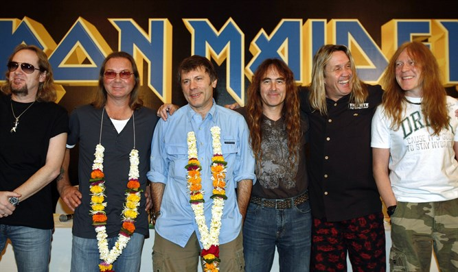 Iron Maiden band members pose for a photo in Mumbai