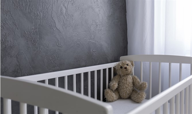 Empty baby crib (stock)