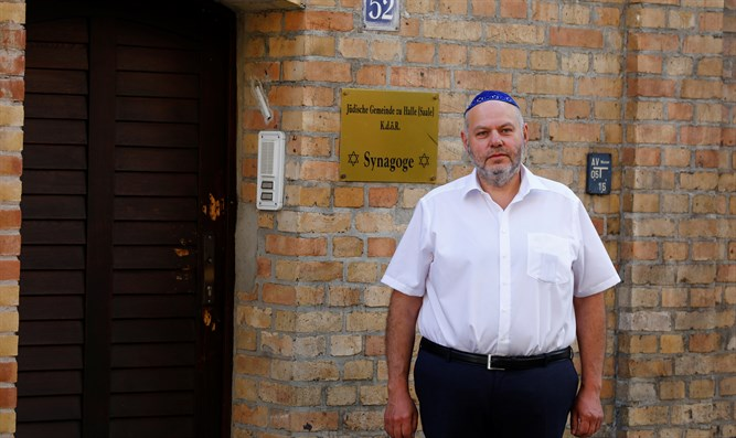 Max Privorozki, head of Halle's Jewish community, stands in front of the synagogue